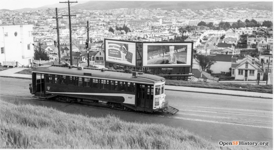 1941. Monterey Blvd at the Detroit Steps. Billboard stand where 403 Monterey is now. OpenSFHistory.org.