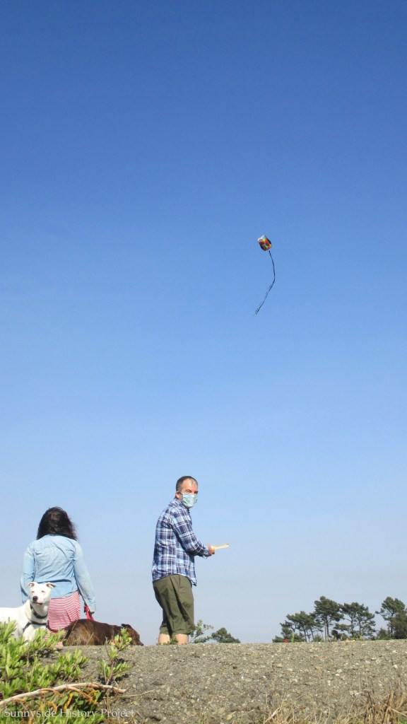 Two Sunnysiders fly a kite. Balboa Reservoir, Sept 2020. Sunnyside History Project. Photo: Amy O'Hair