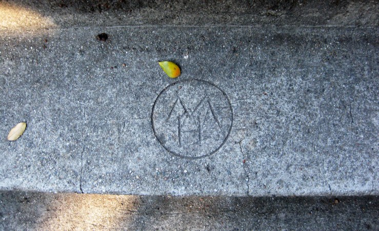 Mark on the Lower Detroit Steps, made when they were laid in the 1930s, presumably by someone on the construction team. I have not solved the mystery of what or who it stands for yet.