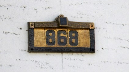 Another example of the very rare black-on-gold number tiles. The surrounding unit has either been painted to match, or was done in the factory, I do not know. Capp Street.