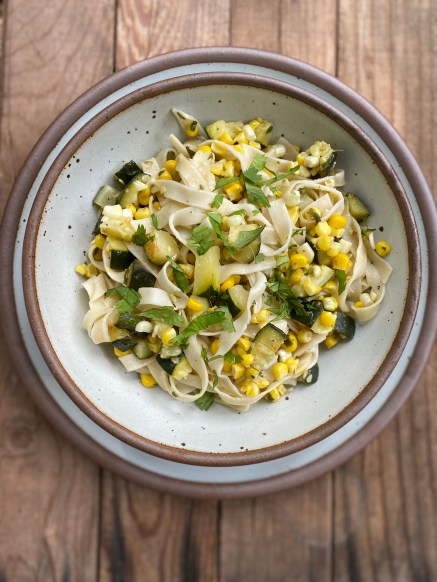 Pasta with zucchini, corn and cilantro