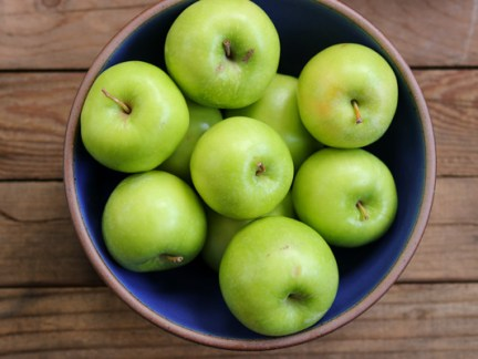 An East Fork Lapis bowl of Granny Smith apples