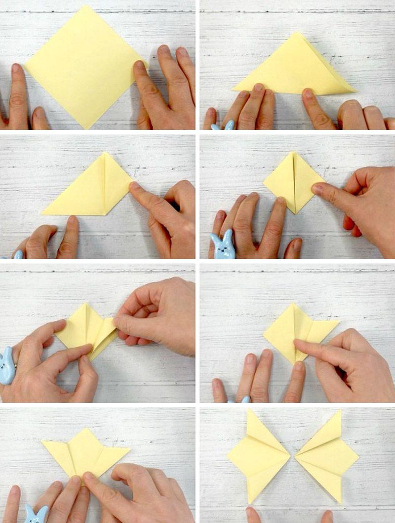 Perhonen paperin seinällä omalla kädellään
