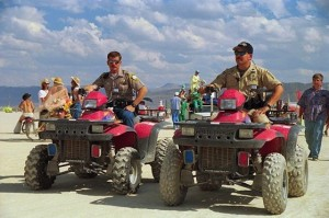 BLM Rangers patrolling the playa in their decorated vehicles