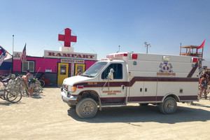 One of the squadron of ambulances parked in front of the EMS Trauma Center near Center Camp