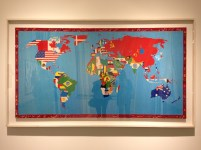 Map of the world with sewn in flags.