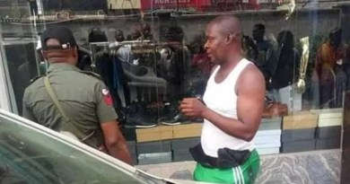 Shame as man caught on Camera stealing cloths from a Boutique in Abuja (photos)