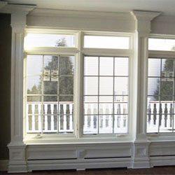 Low wainscot window treatment concealing baseboard heat
