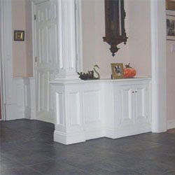wainscot divider with built-in cabinet and column