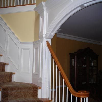 Paneled Round Archway at Staircase