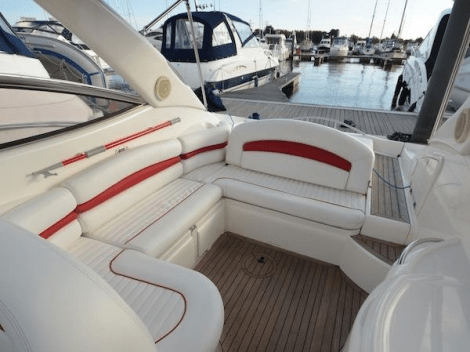 """Providing ample exterior space in the cockpit and helm area, the Superhawk 34 """"TOY BOX"""" boasts well-maintained upholstery"""
