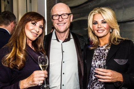 Sunseeker London's Alexis Lewis pictured with close friends John and Claire Caudwell at the Mayfair Luxury Party, Davies Street, W1