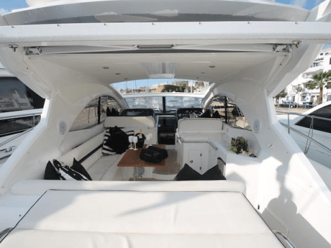 The cockpit of the Portofino 48 is the perfect area for relaxing and entertaining, with the retractable hard top option opening out the space
