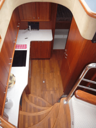 With her Galley down, the Upper Deck space is extended with comfortable living areas