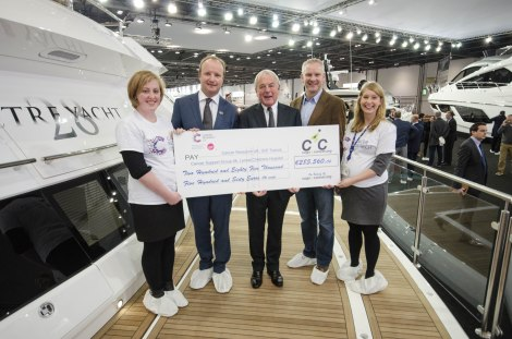 Ben Young of Sunseeker Superyacht Management presents a cheque for €285,560.60  to Cancer Research UK alongside Sunseeker Founder and Autumn Trust Chairman, Robert Braithwaite CBE
