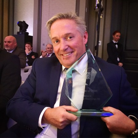 Group Sales Director, Christopher Head, proudly holding the Motor Boat and Yachting award for the Manhattan 52