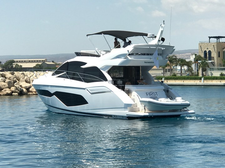 HANDOVER: Blue Braithwaite of Sunseeker London is proud to announce the successful handover of the stunning Manhattan 52 'FIRST'