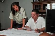 Jason and Brenda Schreyer At Desk - Fort Myers Florida - Sunset Air and Home Services - 239-693-9005 - 225 x 149