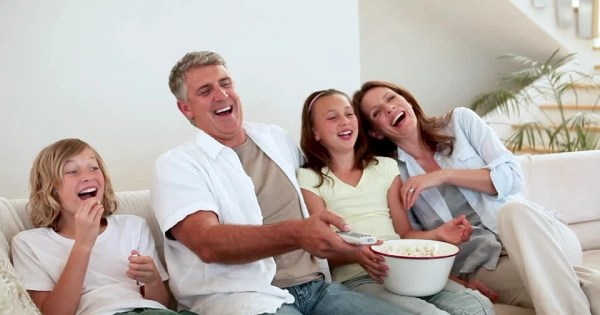 family eating popcorn – Summer Saving Tips - Fort Myers - Sunset Air & Home Services