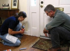 Couple sealing door - Fort Myers - Sunset Air & Home Services