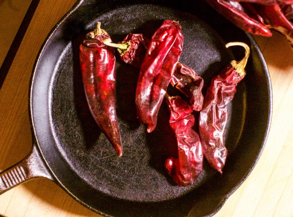 Chiles roasting in iron skillet