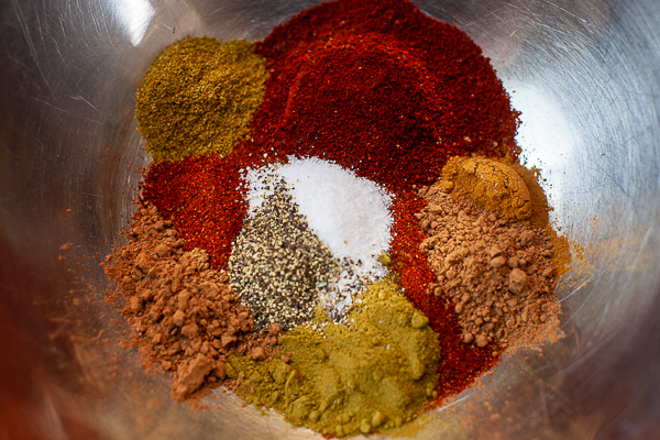 mounds of spices in mixing bowl
