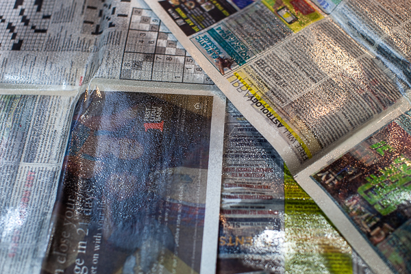 3 sheets of oil soaked newspaper