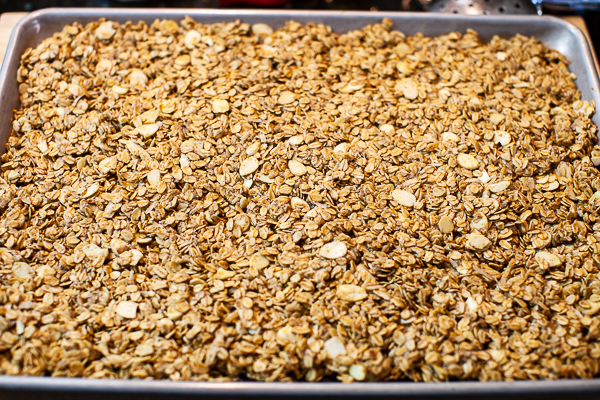 toasted granola spread to edges of sheetpan