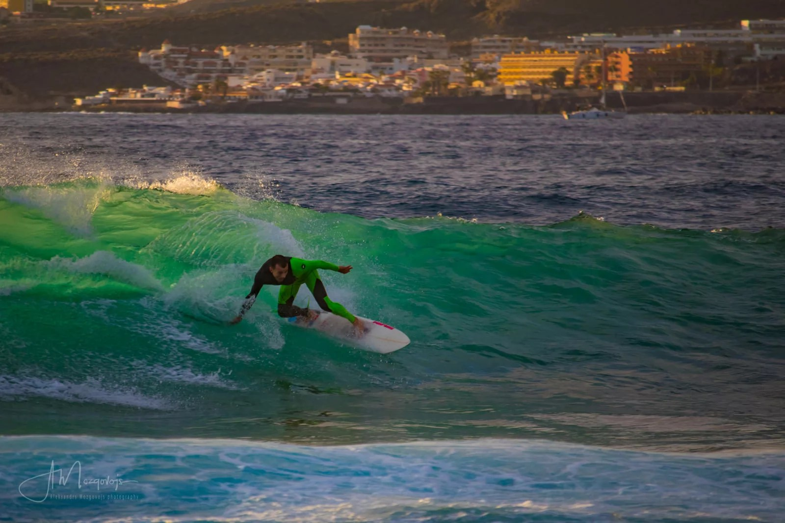A surfer at Las Americas beach in Tenerife, Canary Islands