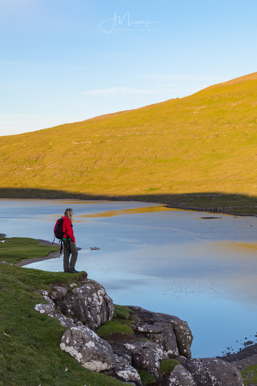 Taking a break on the hike to Trælanípa on the island of Vagar, Faroe Islands