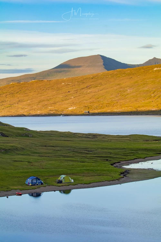 Tents near the lake of Sorvatsvatn (Leitisvatn) on the island of Vagar, Faroe Islands