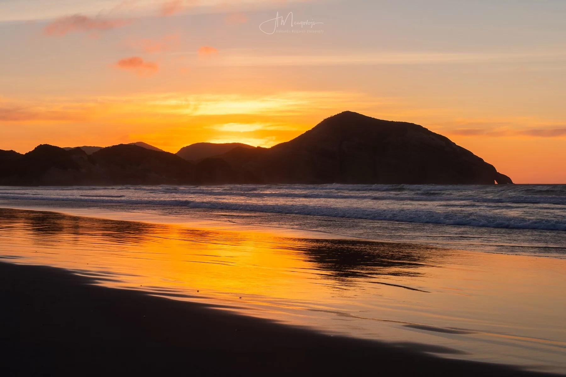 Sunset over Wharariki Beach, New Zealand