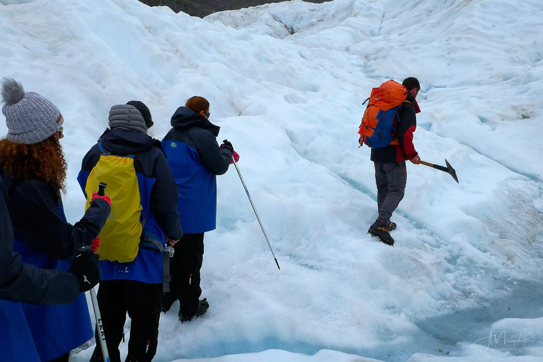 Everyone lining up behind the guide at Fox Glacier hell hike