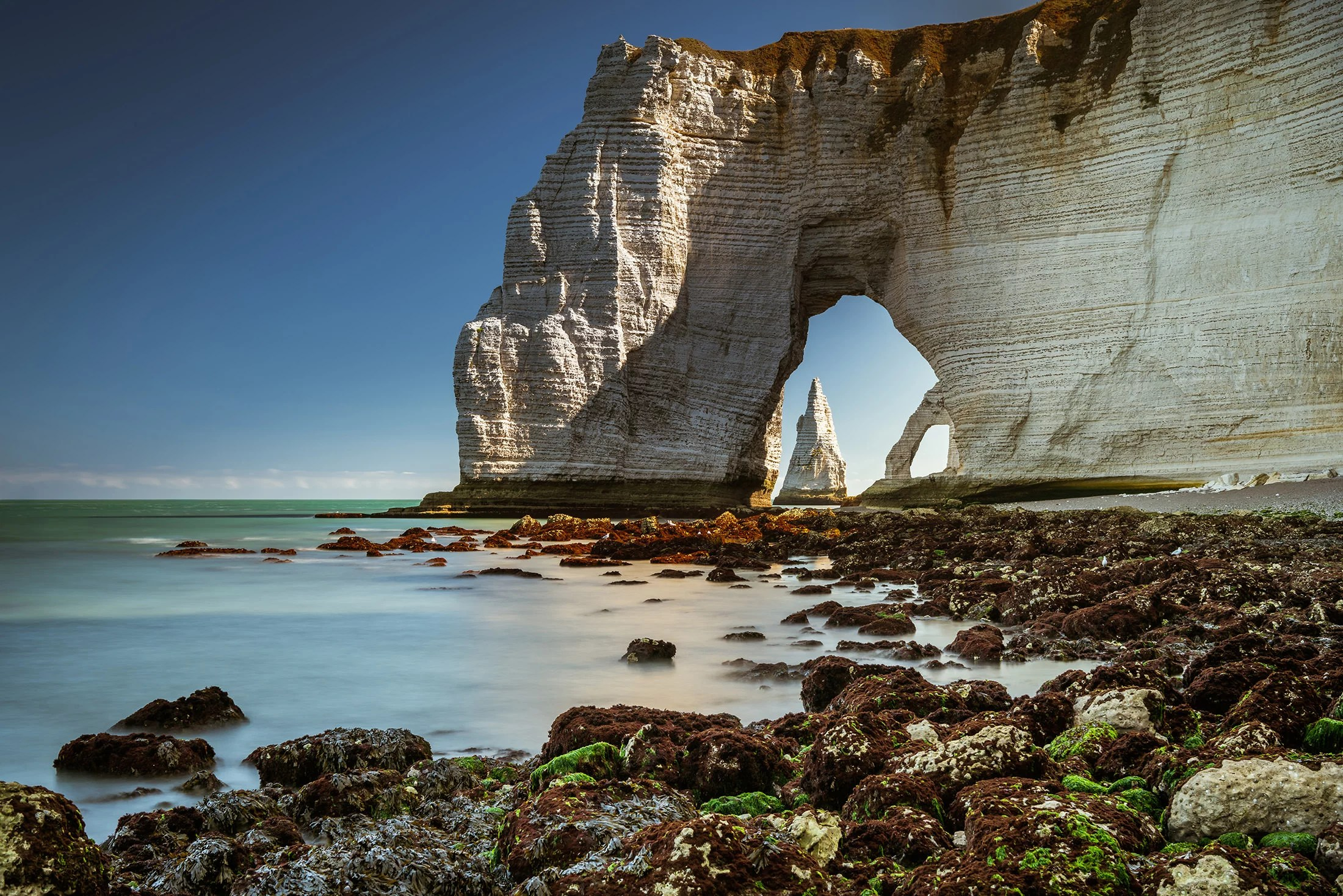 Two arches and a needle during low tide