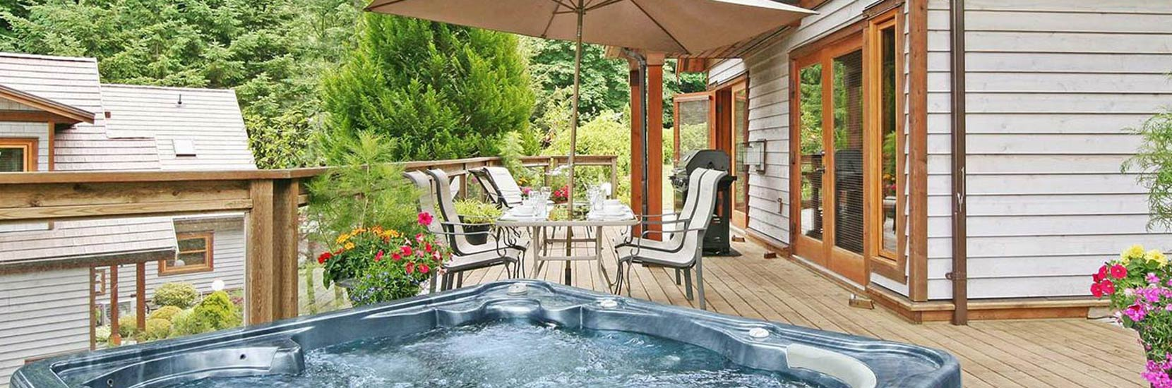 Each Executive Cottage features a large deck with private 5 person hot tub with LED lighting