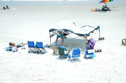 Dismantling the beach canopy