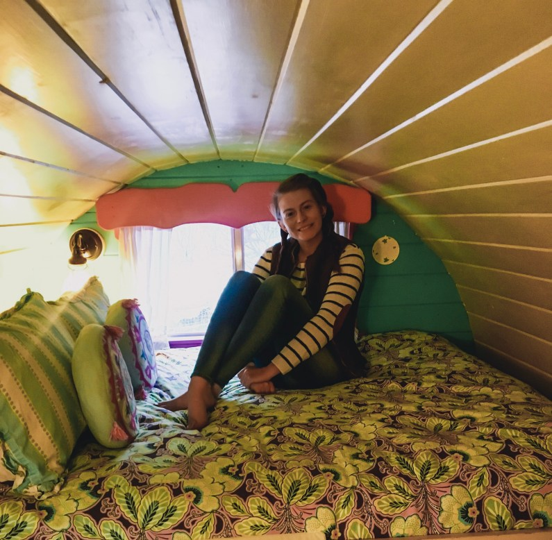 Me cozying up on our Gypsy Wagon bed