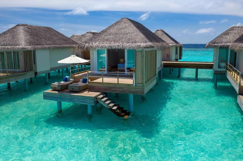 over water villa bungalow at baglioni resort maldives with stairs into the lagoon sea
