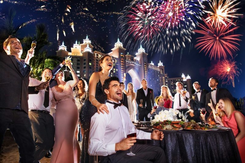 fireworks and glamorous people celebrate new year's eve at atlantis dubai