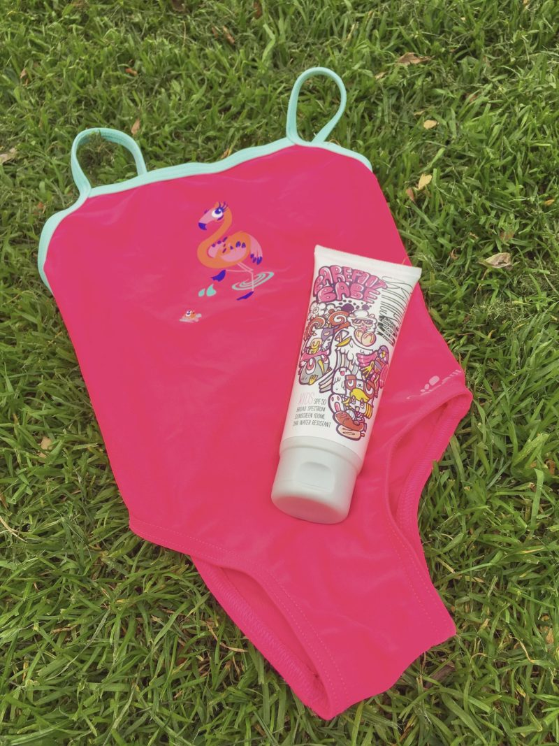 sunscreen for babies and kids - skinnies kids - pink flamingo girl's swimsuit with sunscreen