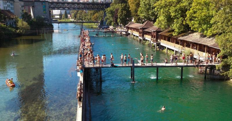 overview of Unterer Letten RIver Swimming Area with people swimming and kayaking
