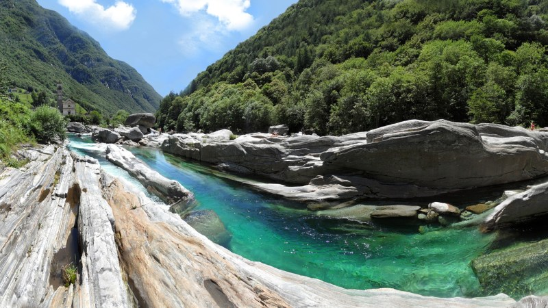 Verzasca River emerald water flowing through rocks