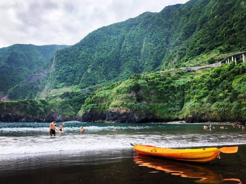 black sand seixal beach madeira yellow kayak