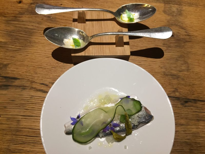 Spoonfuls of Oyster Leaf accompanied by freshly caught fish from Lake Lucerne