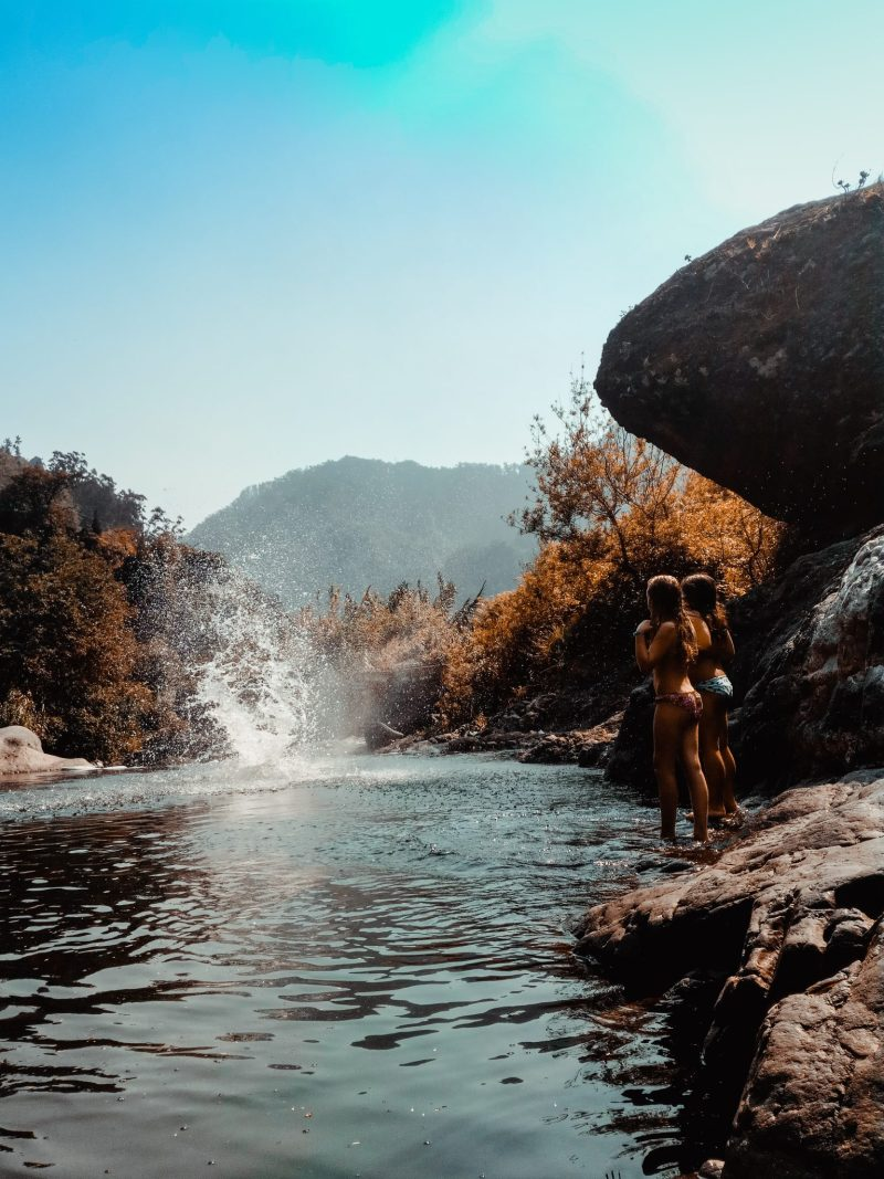 Splashing in the Poco dos Chefes river with two bikini girls