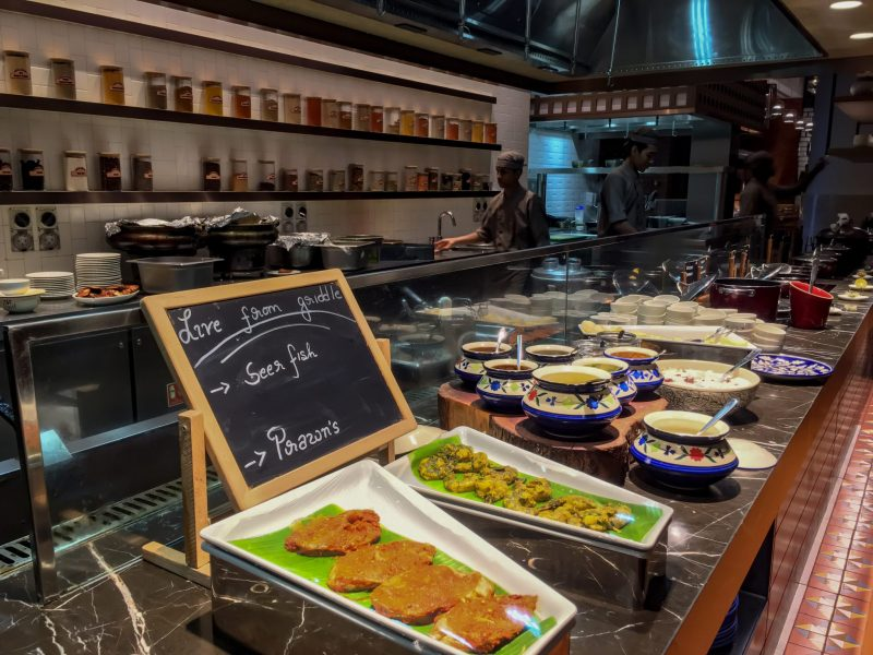 open concept kitchen at malabar cafe with buffet line of local curries