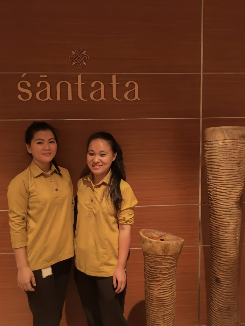 two spa therapist ladies smiling under the sign of Santata Spa