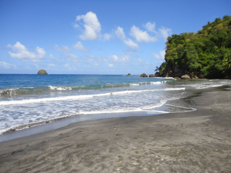 Black sand shoreline of martinique beach