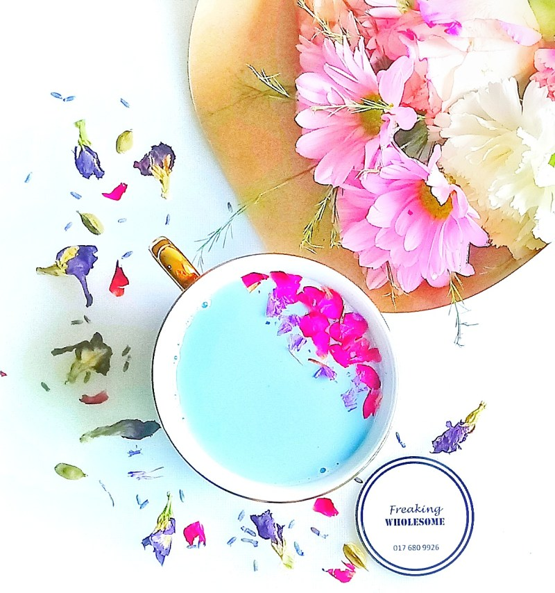 pretty cup of blue tea with butterfly pea flowers and dried lavender
