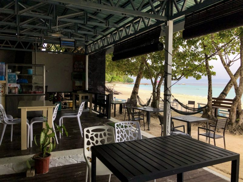 mamak restaurant summer bay lang tengah dining area overlooking beach with hammocks and palm trees